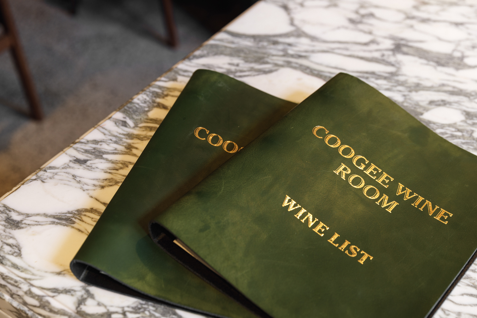 sydney design social coogee wine room logo branding menu covers green leather