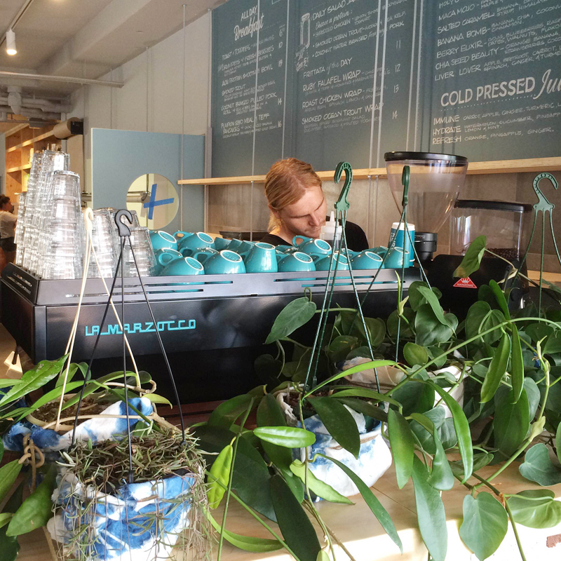 sydney-design-social-ruby-lane-man-making-coffee-teal-coffee-cups-machine-plants-menu-board