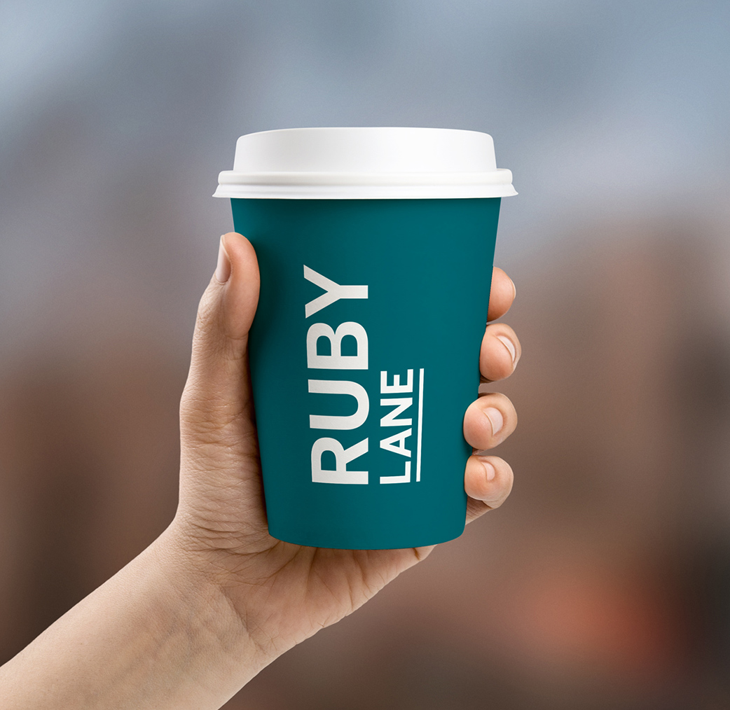 sydney-design-social-ruby-lane-teal-coffee-cup-white-lid-in-hand